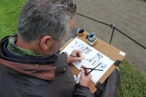 Mark draws in ink